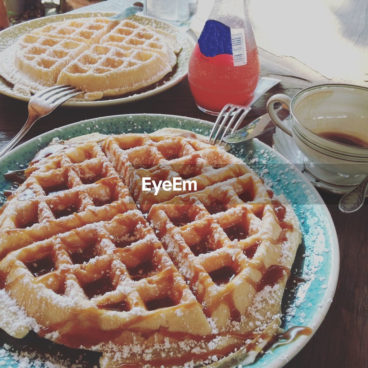 High Angle View Of Waffles In Plates On Table