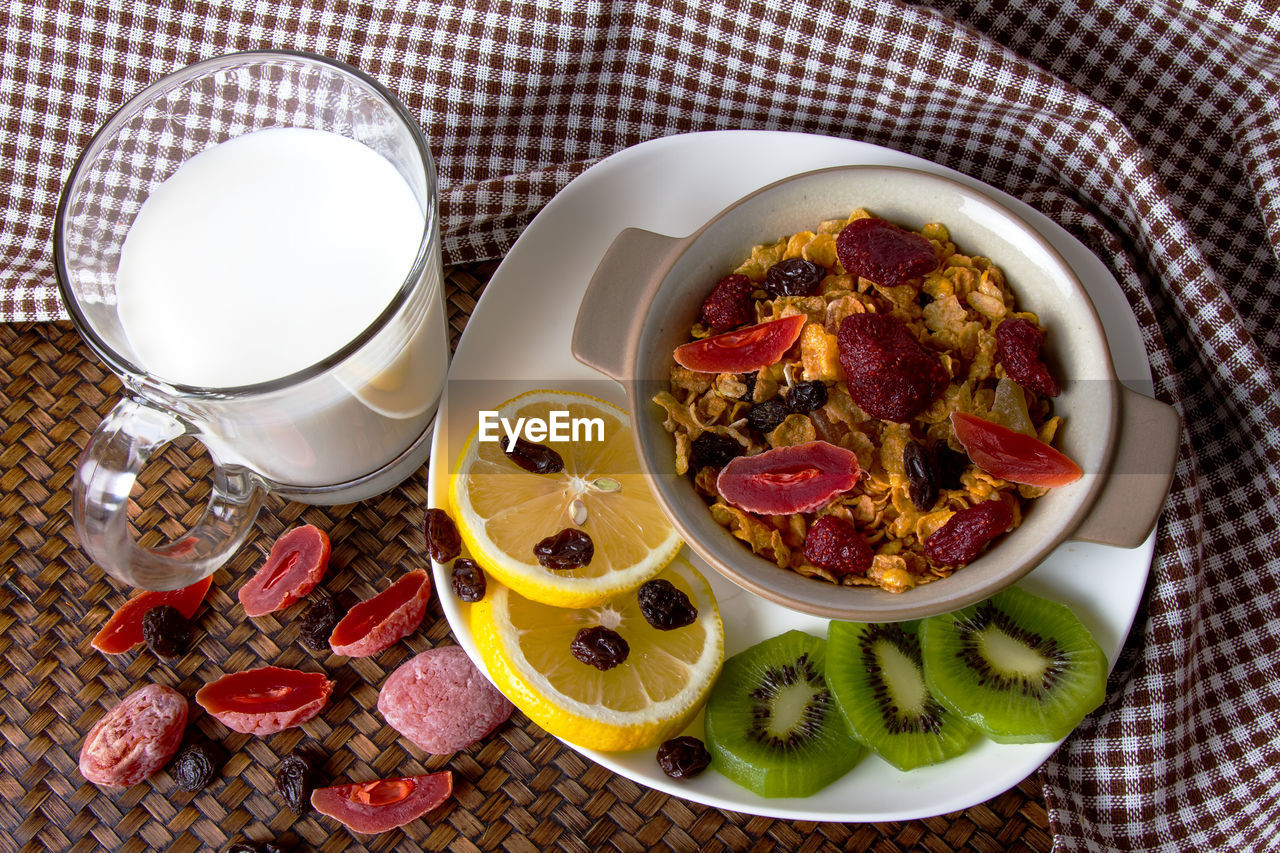 food and drink, food, freshness, healthy eating, high angle view, still life, table, fruit, indoors, wellbeing, drink, ready-to-eat, refreshment, no people, plate, bowl, glass, kitchen utensil, slice, breakfast