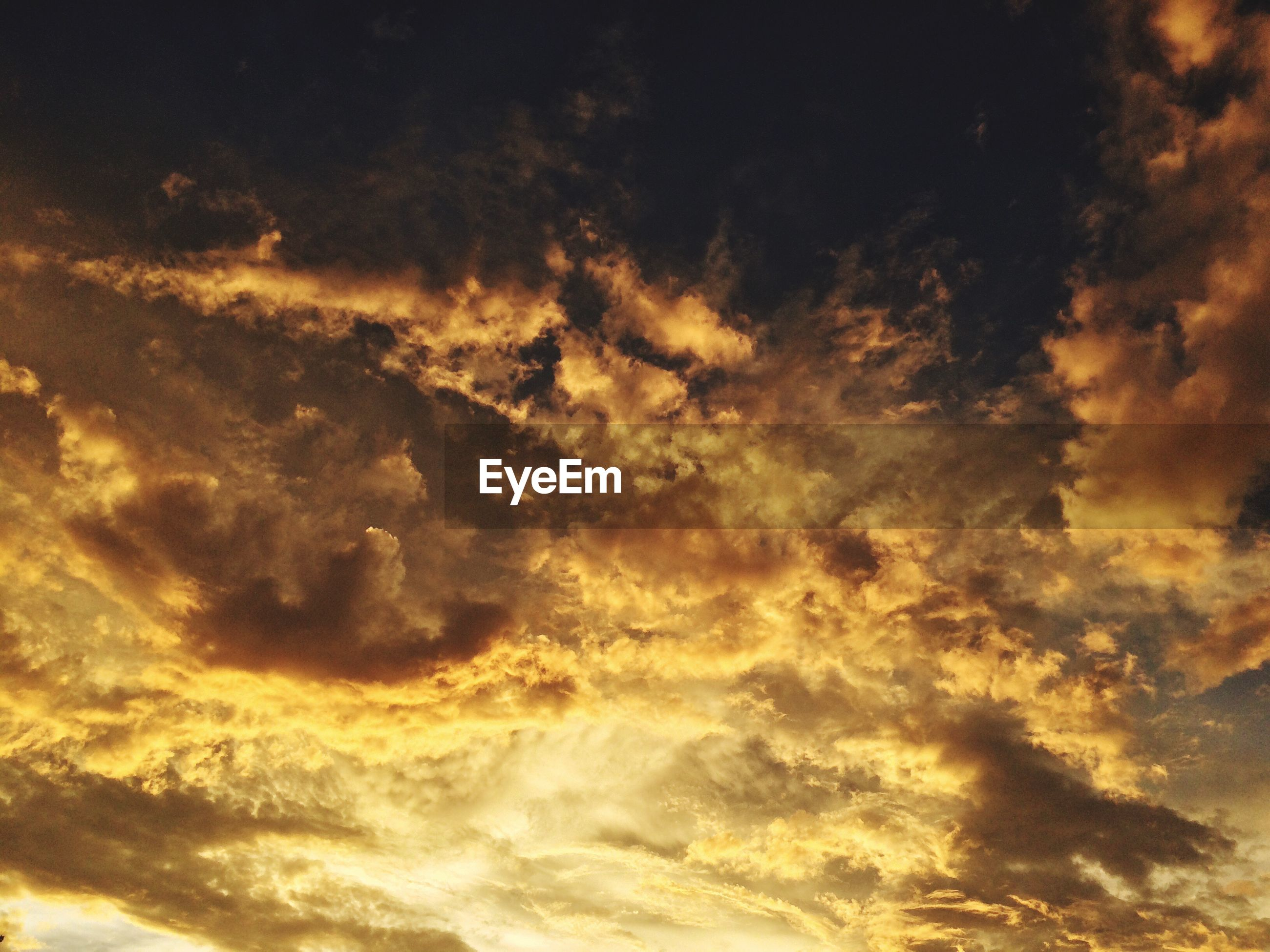 AERIAL VIEW OF DRAMATIC SKY AT SUNSET