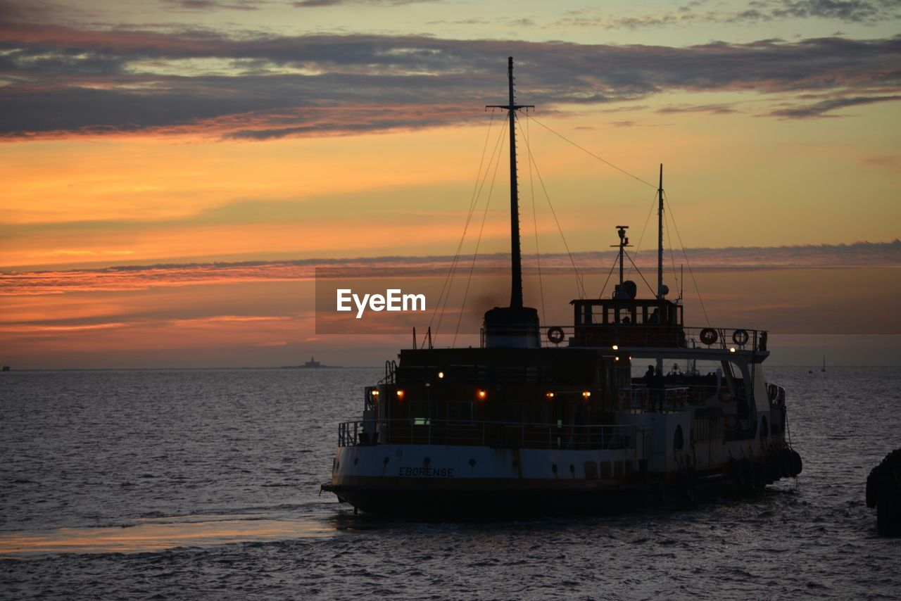 sunset, nautical vessel, sea, transportation, sky, water, cloud - sky, boat, mode of transport, nature, horizon over water, outdoors, silhouette, beauty in nature, no people, ship, scenics, day