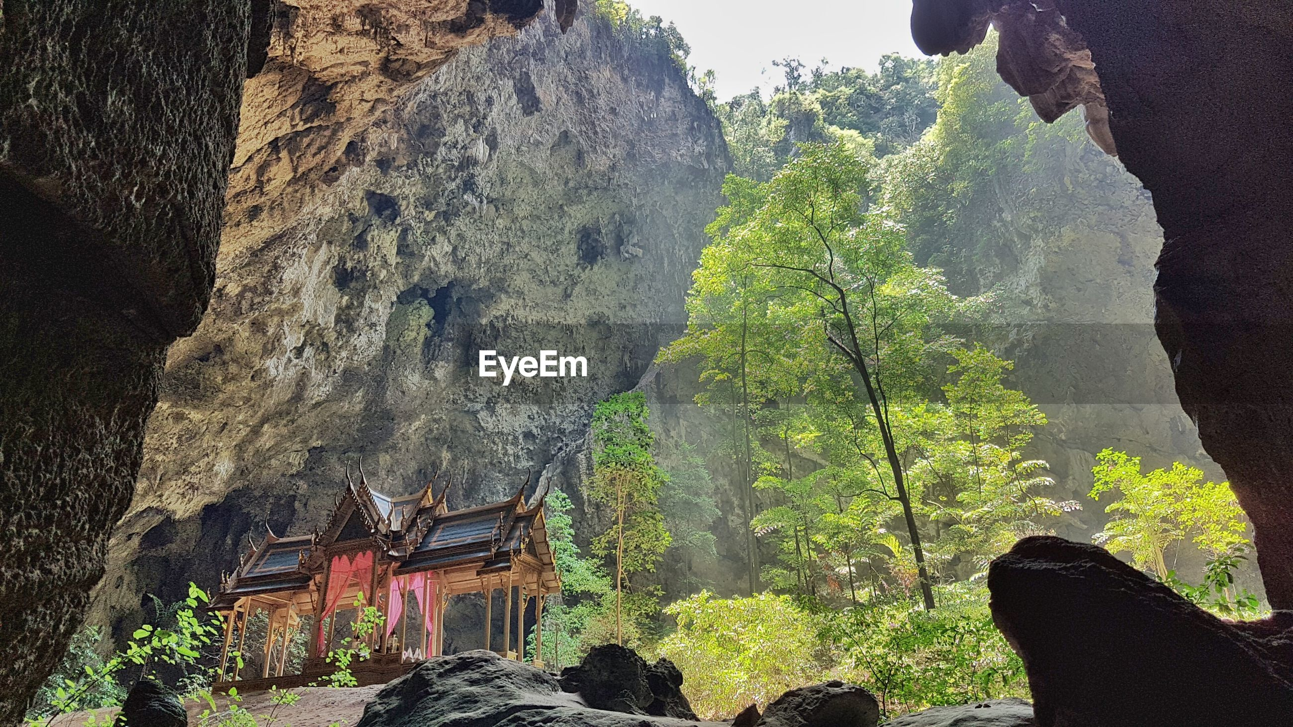 SCENIC VIEW OF CAVE AND MOUNTAINS