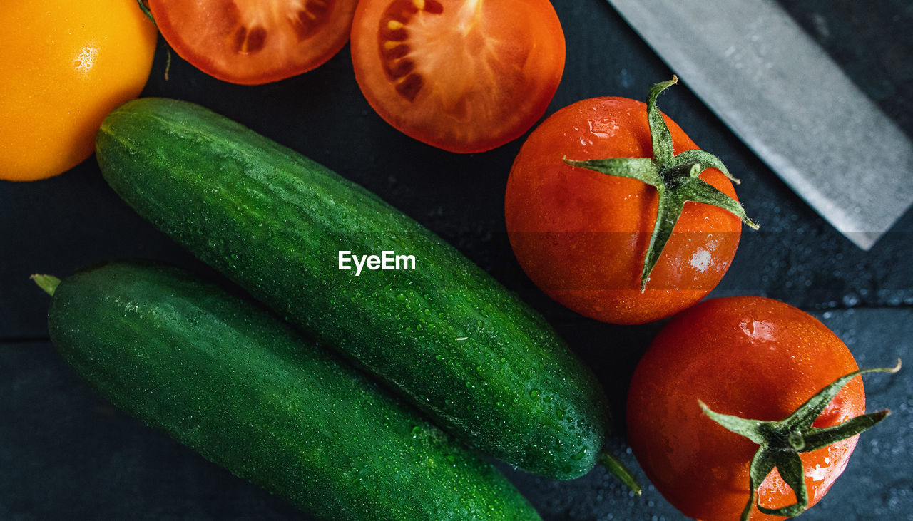 food, food and drink, vegetable, freshness, healthy eating, wellbeing, fruit, orange color, tomato, green color, still life, no people, indoors, close-up, high angle view, cucumber, table, group of objects, nature, orange, ripe