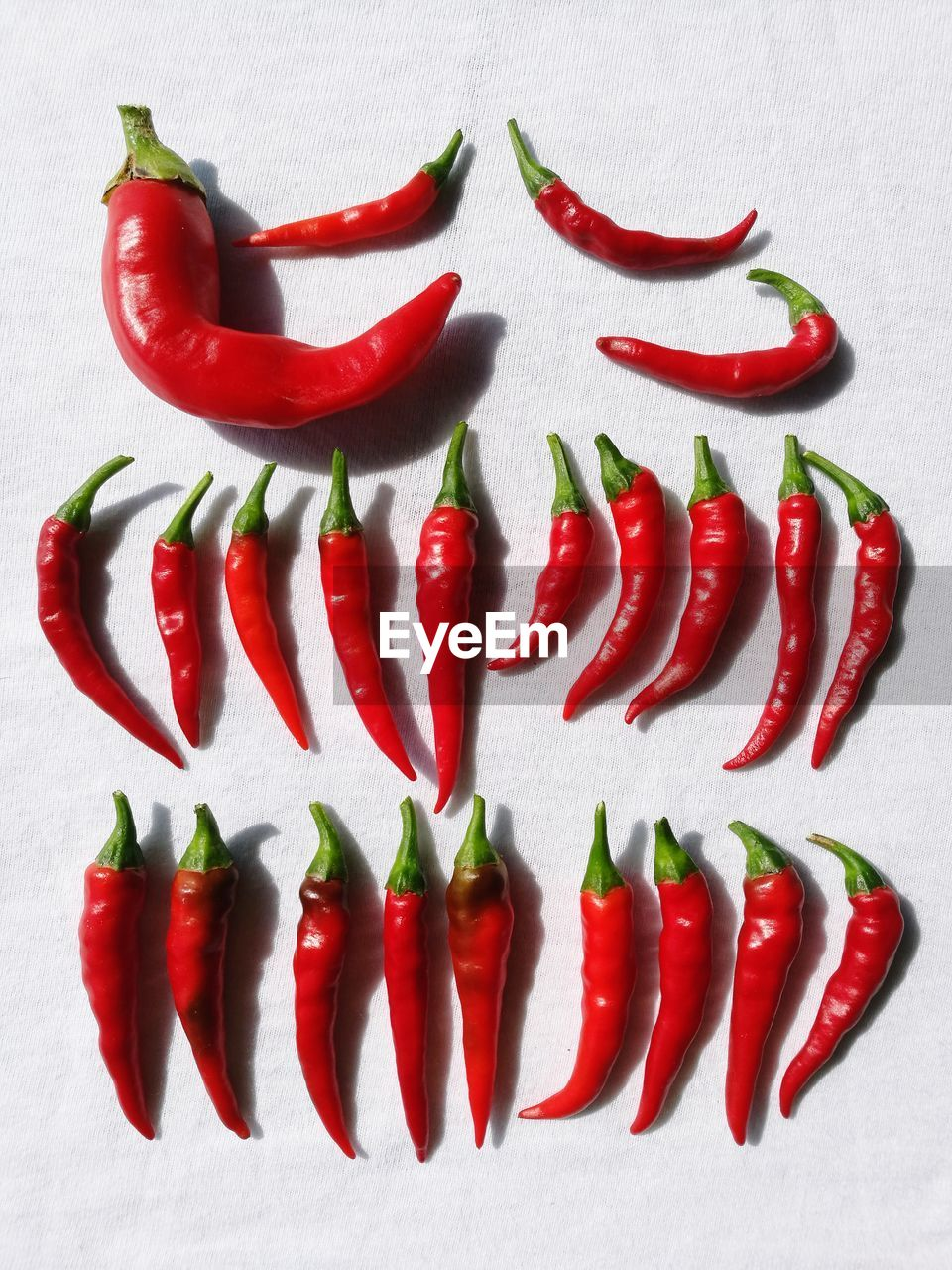 High angle view of red chili peppers arranged on table