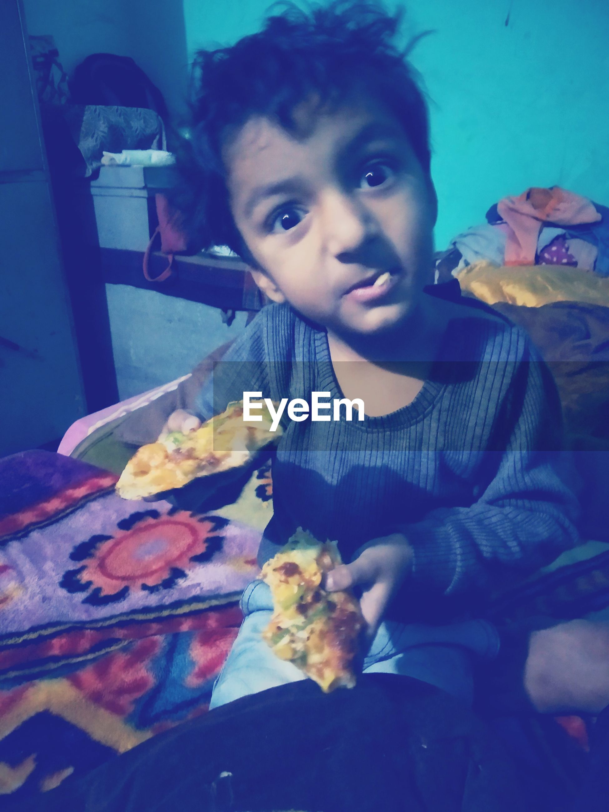 Portrait of boy holding food