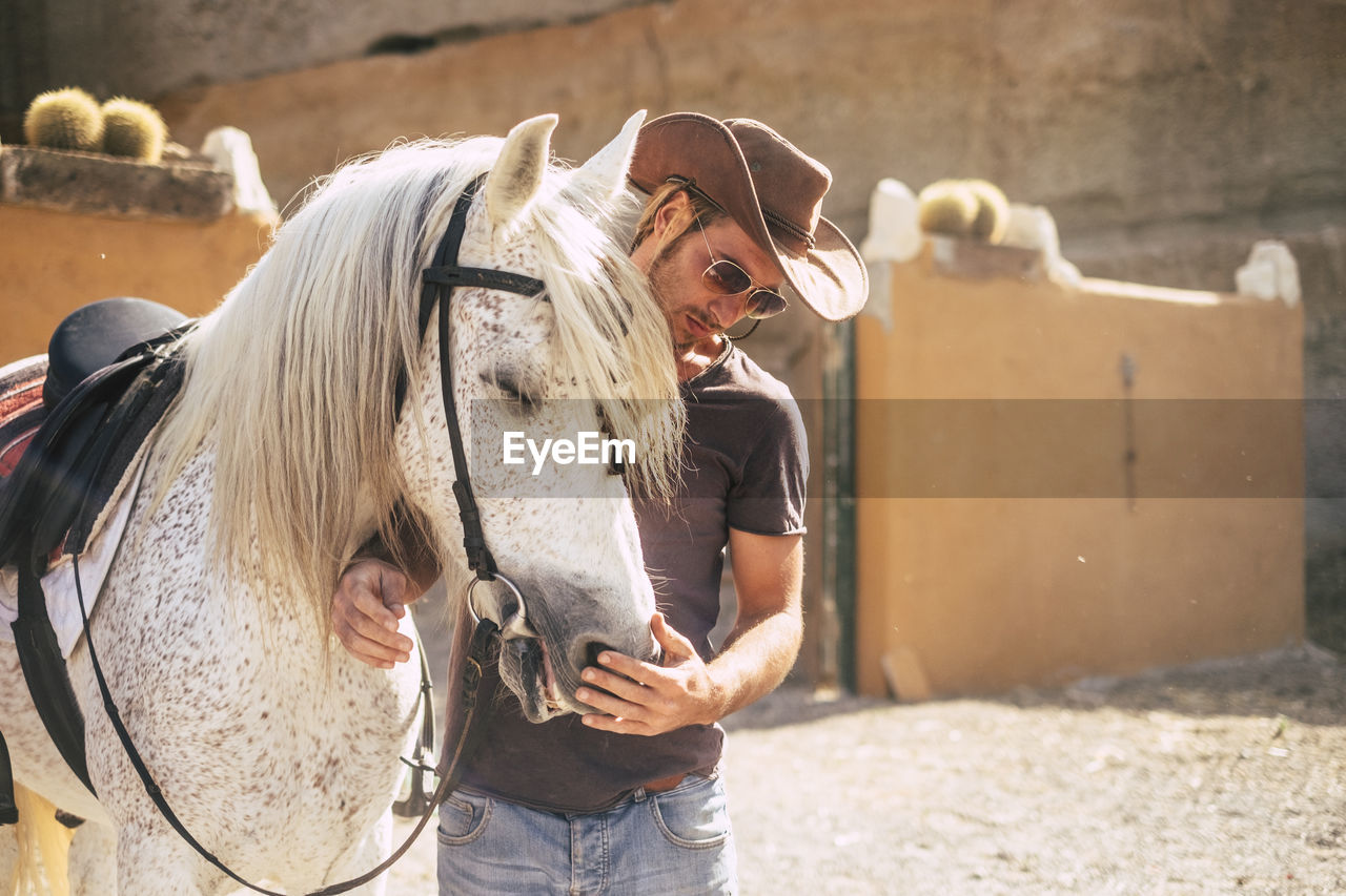 Young Cowboy With Horse At Ranch