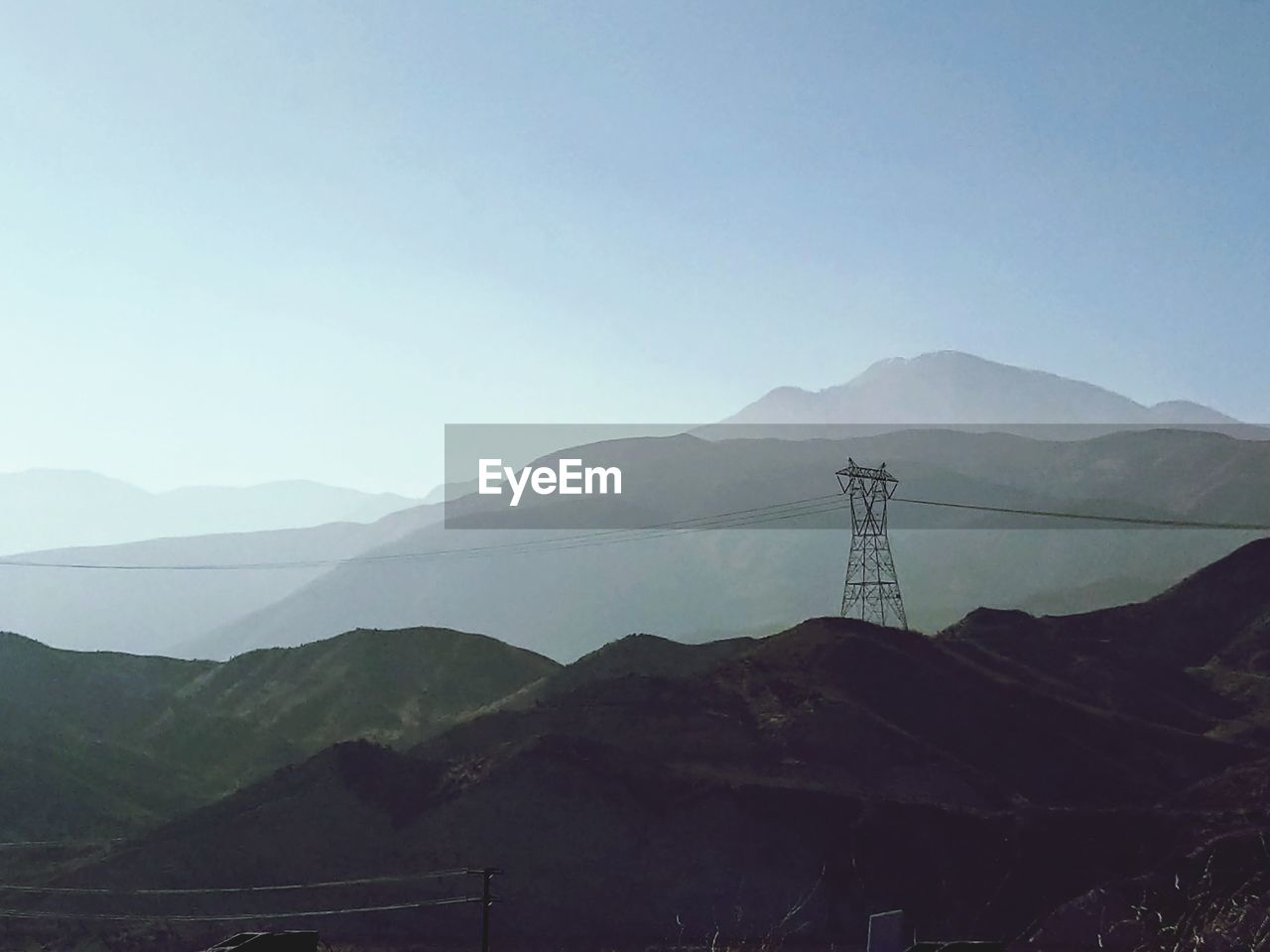 mountain, sky, mountain range, scenics - nature, beauty in nature, environment, tranquil scene, no people, tranquility, nature, copy space, landscape, non-urban scene, electricity, clear sky, cable, electricity pylon, day, outdoors, connection, mountain peak, power supply