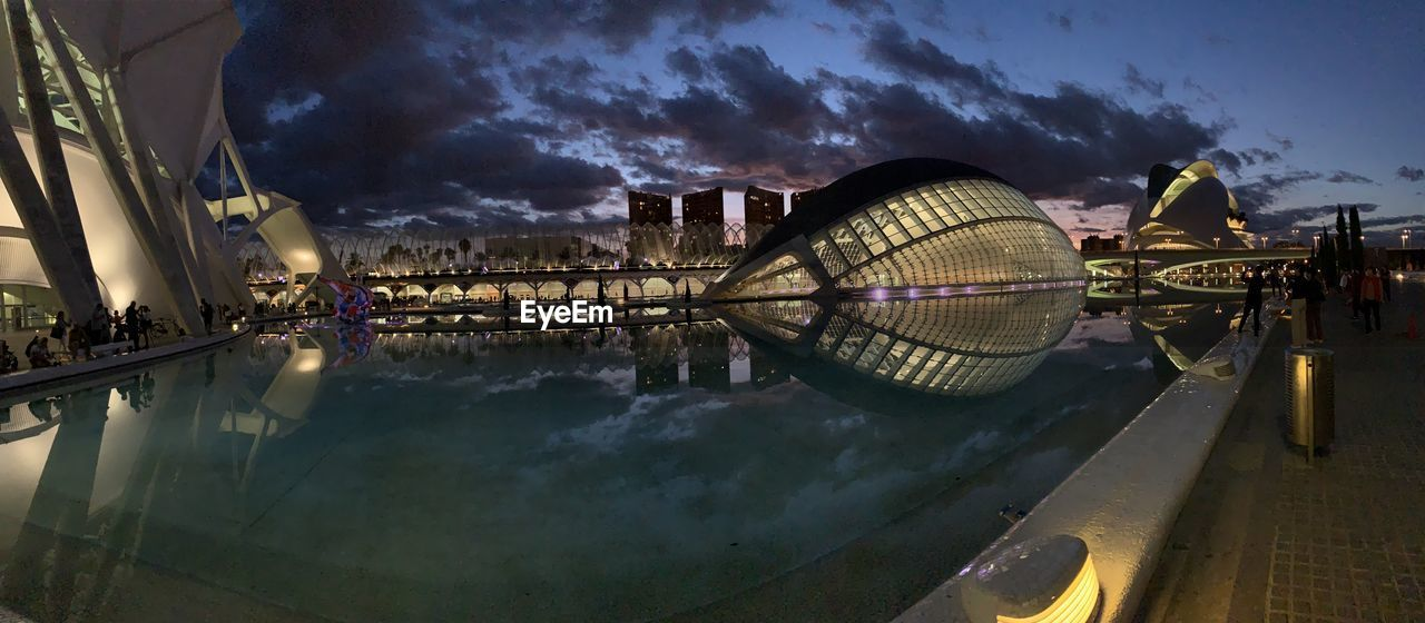 water, sky, cloud - sky, nature, architecture, reflection, built structure, building exterior, nautical vessel, transportation, no people, outdoors, dusk, technology, illuminated, connection, mode of transportation, lake, travel destinations