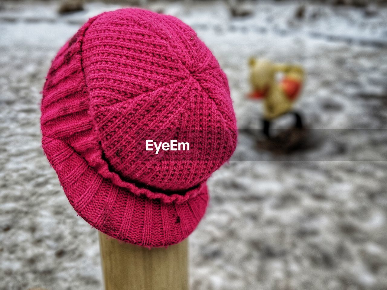 close-up, hat, focus on foreground, knit hat, clothing, art and craft, no people, wool, textile, day, creativity, still life, winter, red, craft, pink color, knitted, flower, warm clothing, glove, softness