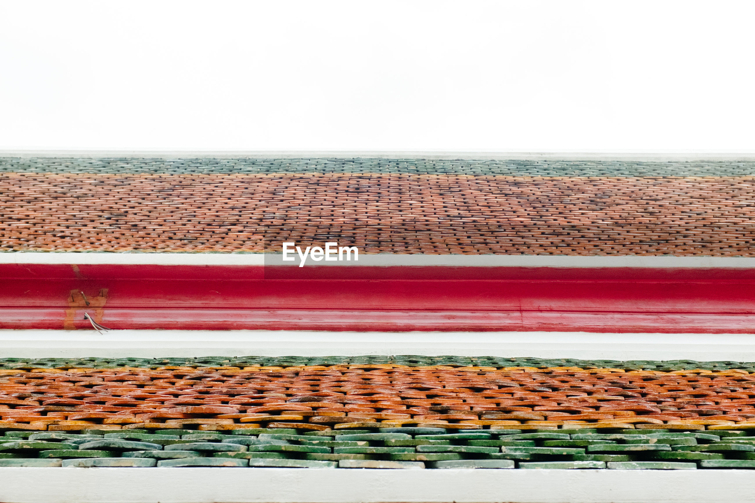 VIEW OF ROOF TILES ON BUILDING TERRACE AGAINST SKY