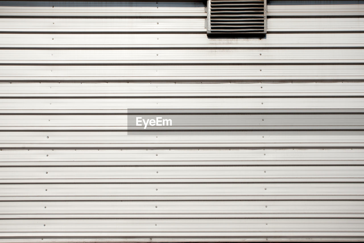 shutter, full frame, backgrounds, no people, pattern, architecture, metal, closed, window, corrugated iron, day, repetition, wall - building feature, iron, built structure, blinds, security, in a row, building exterior, safety, corrugated, garage