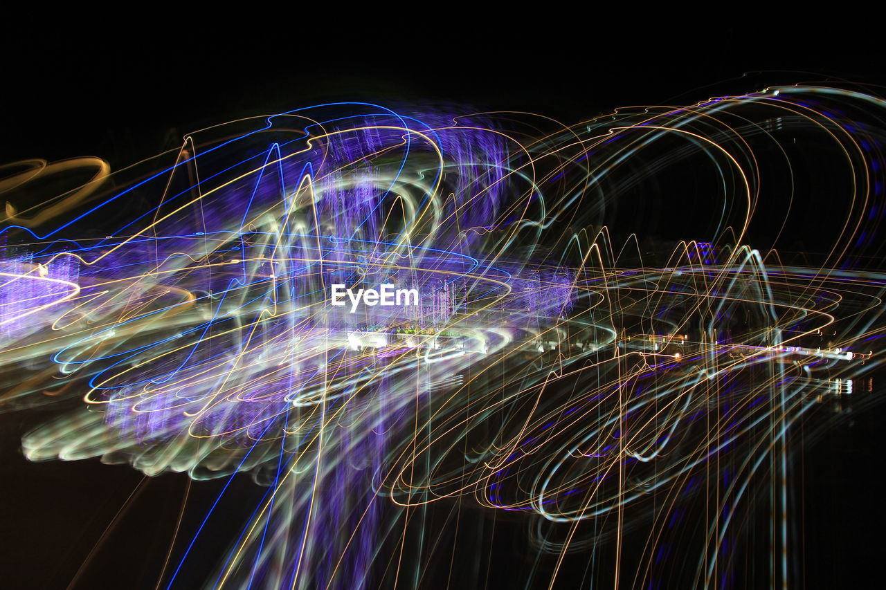 motion, illuminated, long exposure, light trail, night, speed, light painting, blurred motion, glowing, multi colored, pattern, light - natural phenomenon, abstract, no people, arts culture and entertainment, black background, creativity, light, studio shot, complexity, fiber optic, purple, wire wool