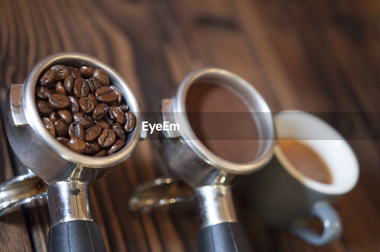 Tilt Image Of Coffee In Filter And Cup On Table