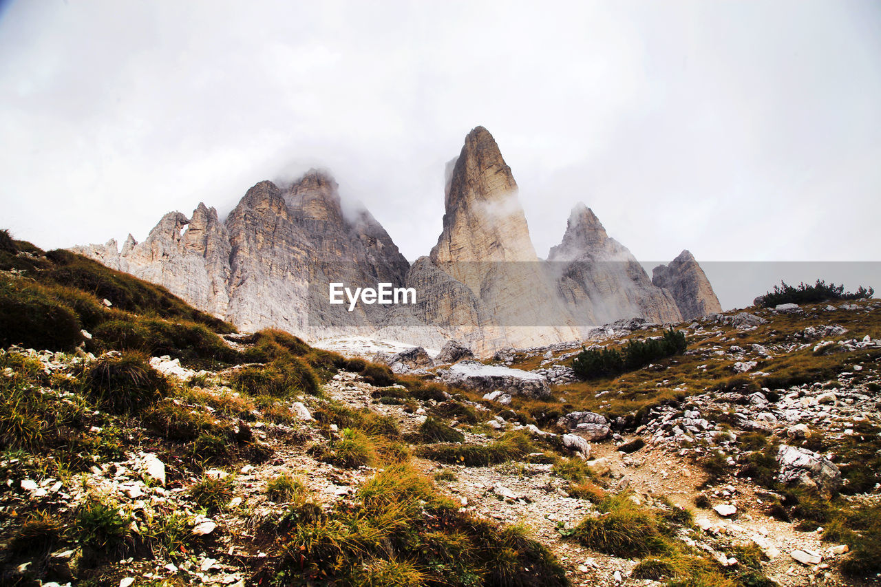 Low Angle View Of Dolomites Against Sky