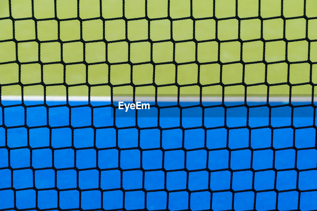 Hockey field seen through net