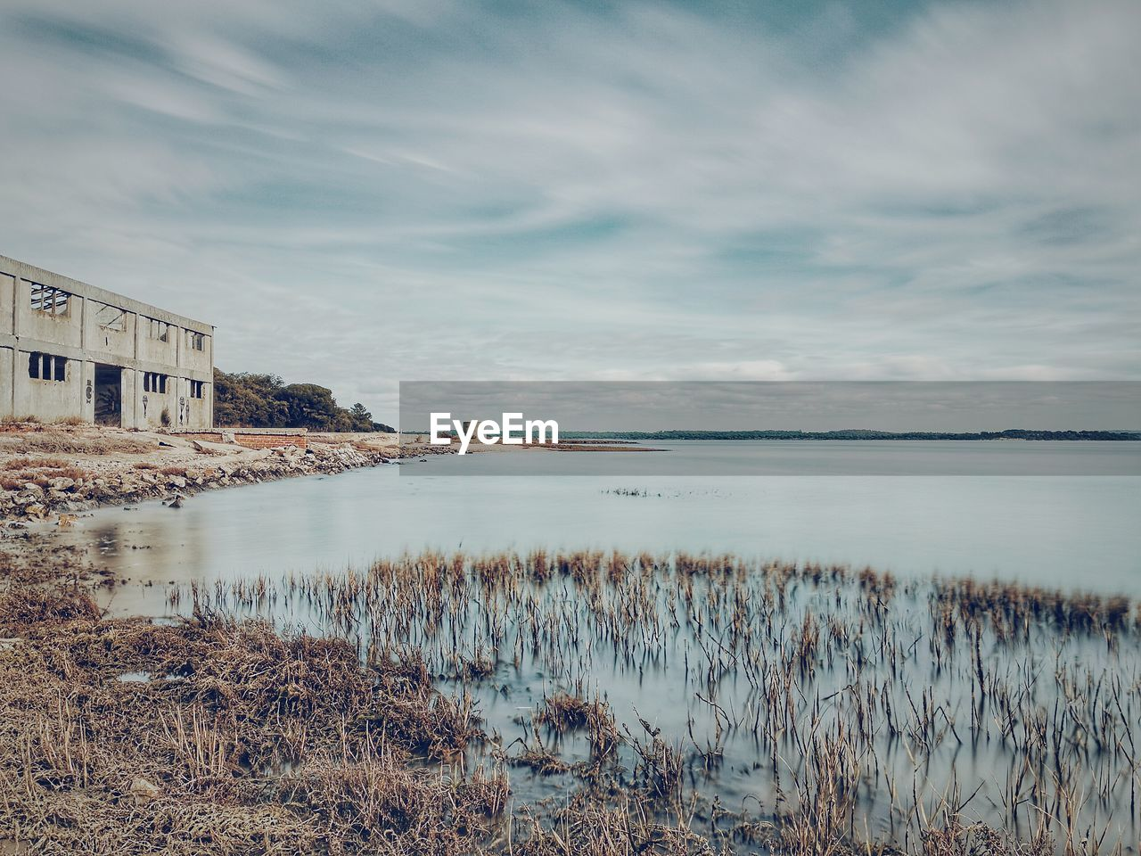 water, sky, nature, cloud - sky, architecture, no people, built structure, beauty in nature, scenics, outdoors, tranquility, lake, day, building exterior, grass