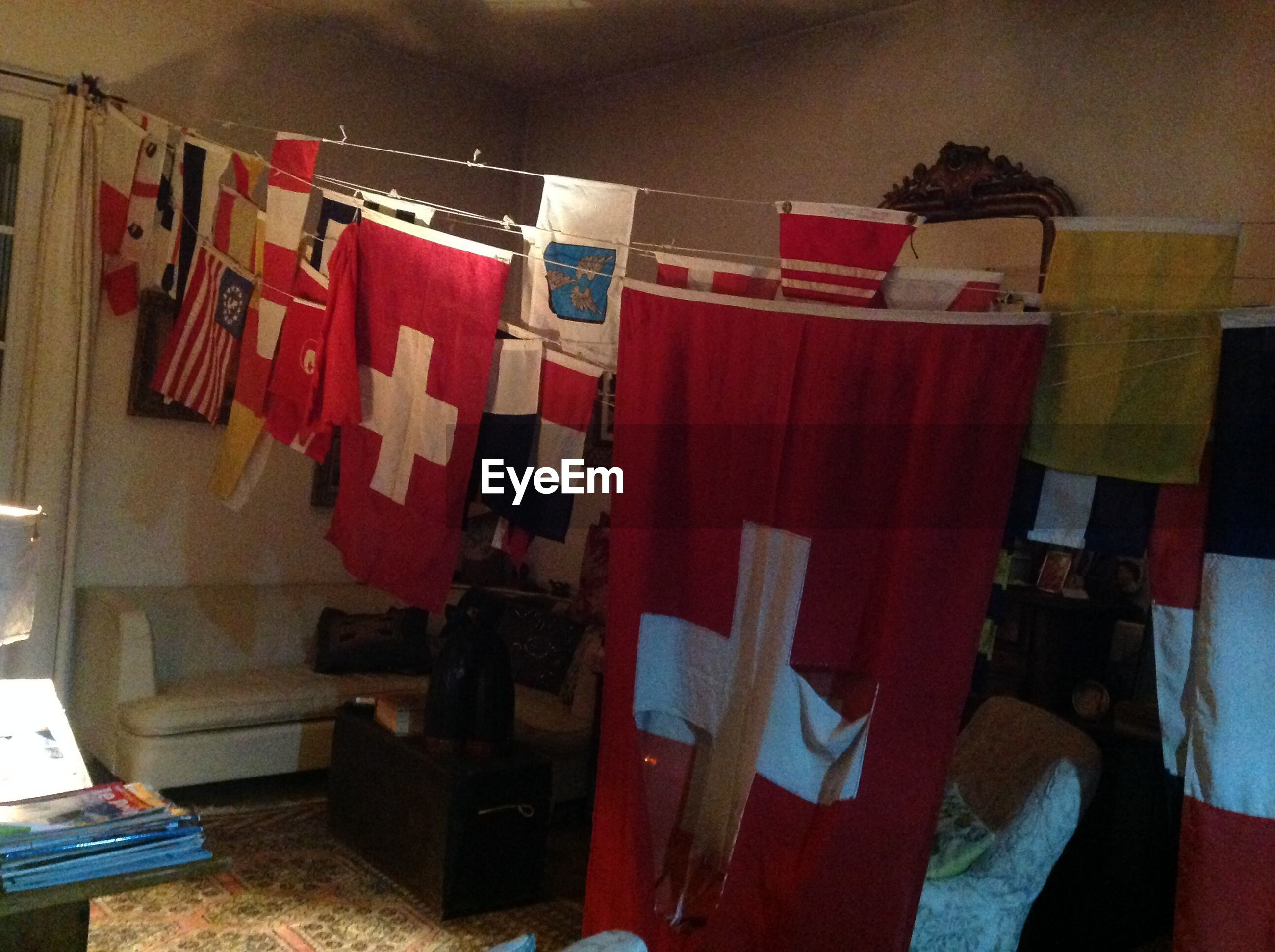 Flags hanging on clothesline in room