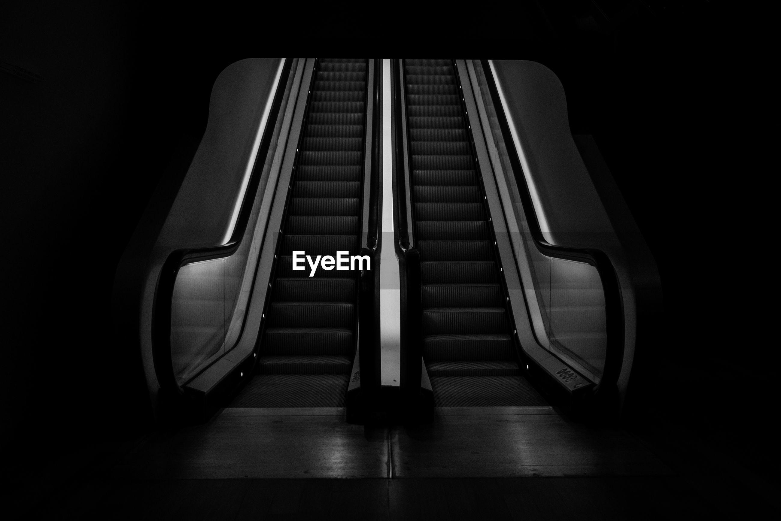 Empty escalator in building