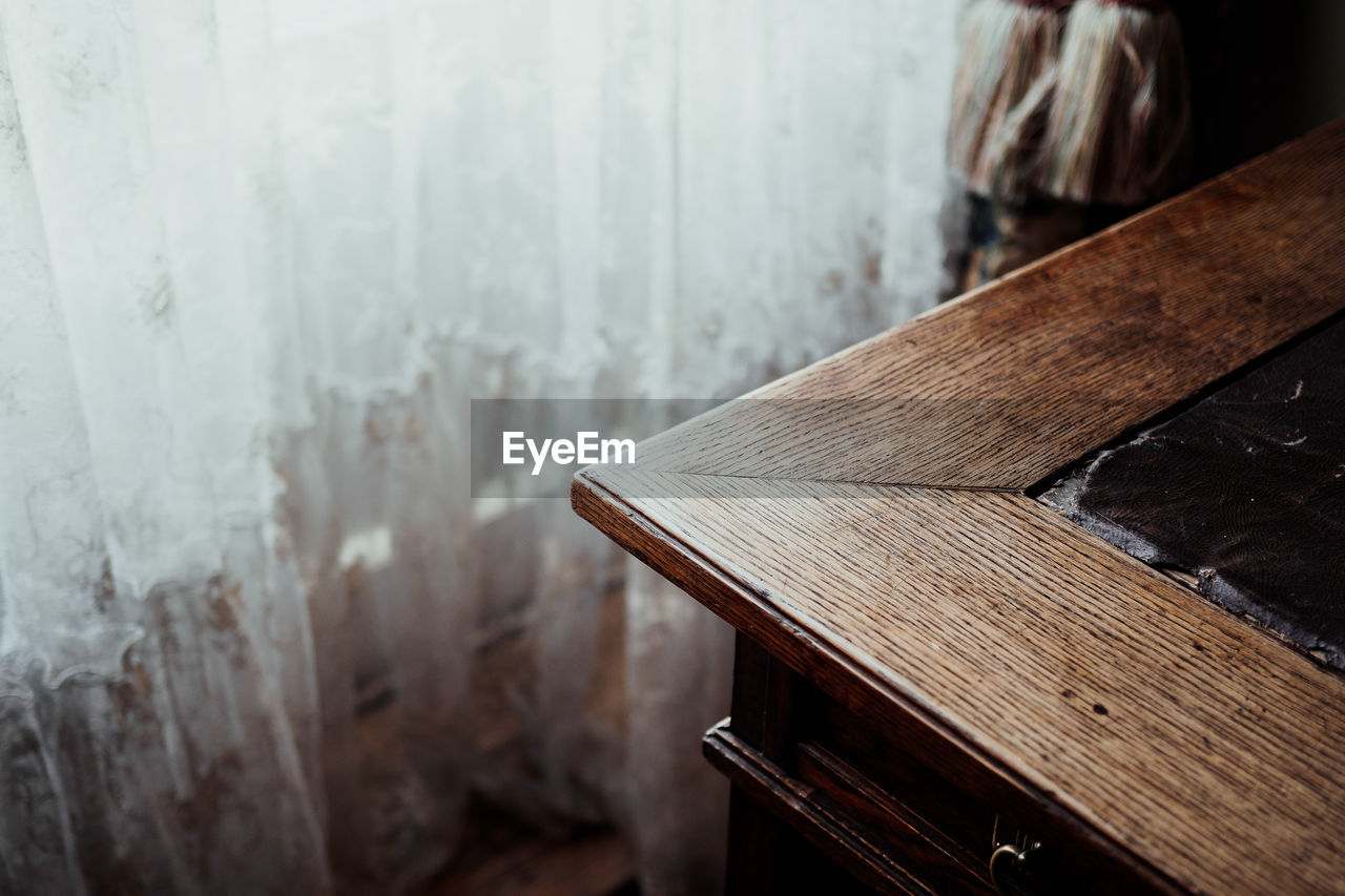wood - material, indoors, focus on foreground, no people, close-up, table, brown, day, still life, wood, selective focus, architecture, music, textured, empty, high angle view, book, built structure, plank