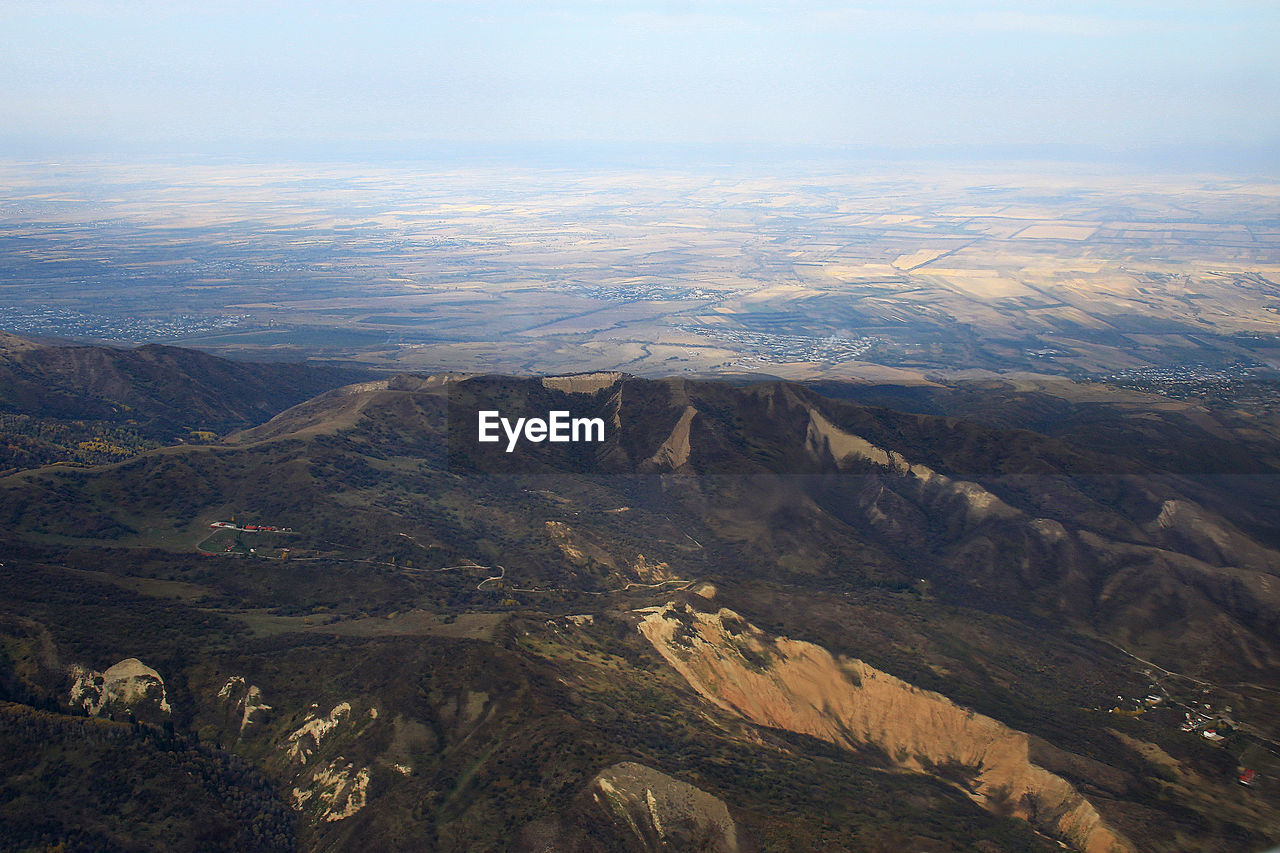 A view over the mountain valley and fields in the distance in autumn, sunlight, aerial photography