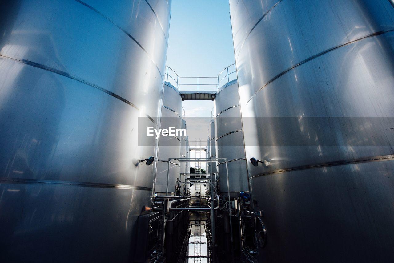 Low Angle View Of Storage Tanks At Factory