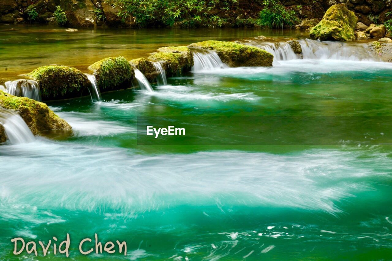 water, waterfall, motion, long exposure, beauty in nature, nature, scenics, blurred motion, river, green color, outdoors, no people, day, tree, grass, freshness