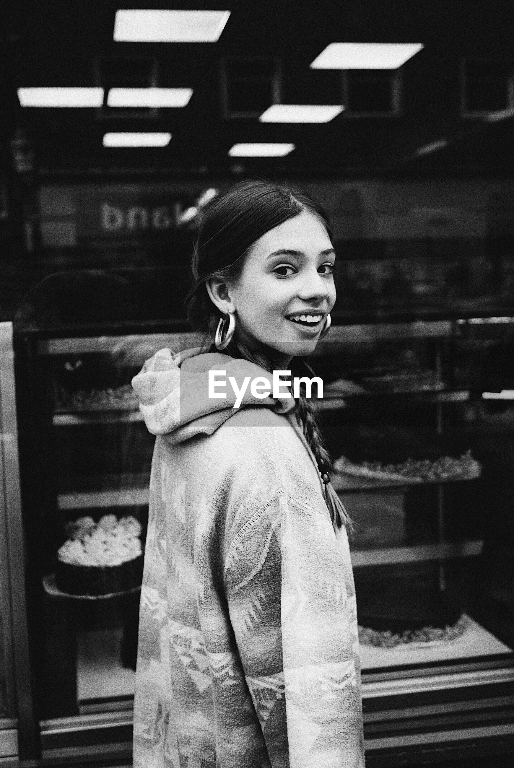 retail, smiling, casual clothing, lifestyles, happiness, young adult, real people, one person, leisure activity, standing, cheerful, young women, store, customer, consumerism, indoors, market, night, beautiful woman, food, freshness, one young woman only, supermarket, adult, adults only, people