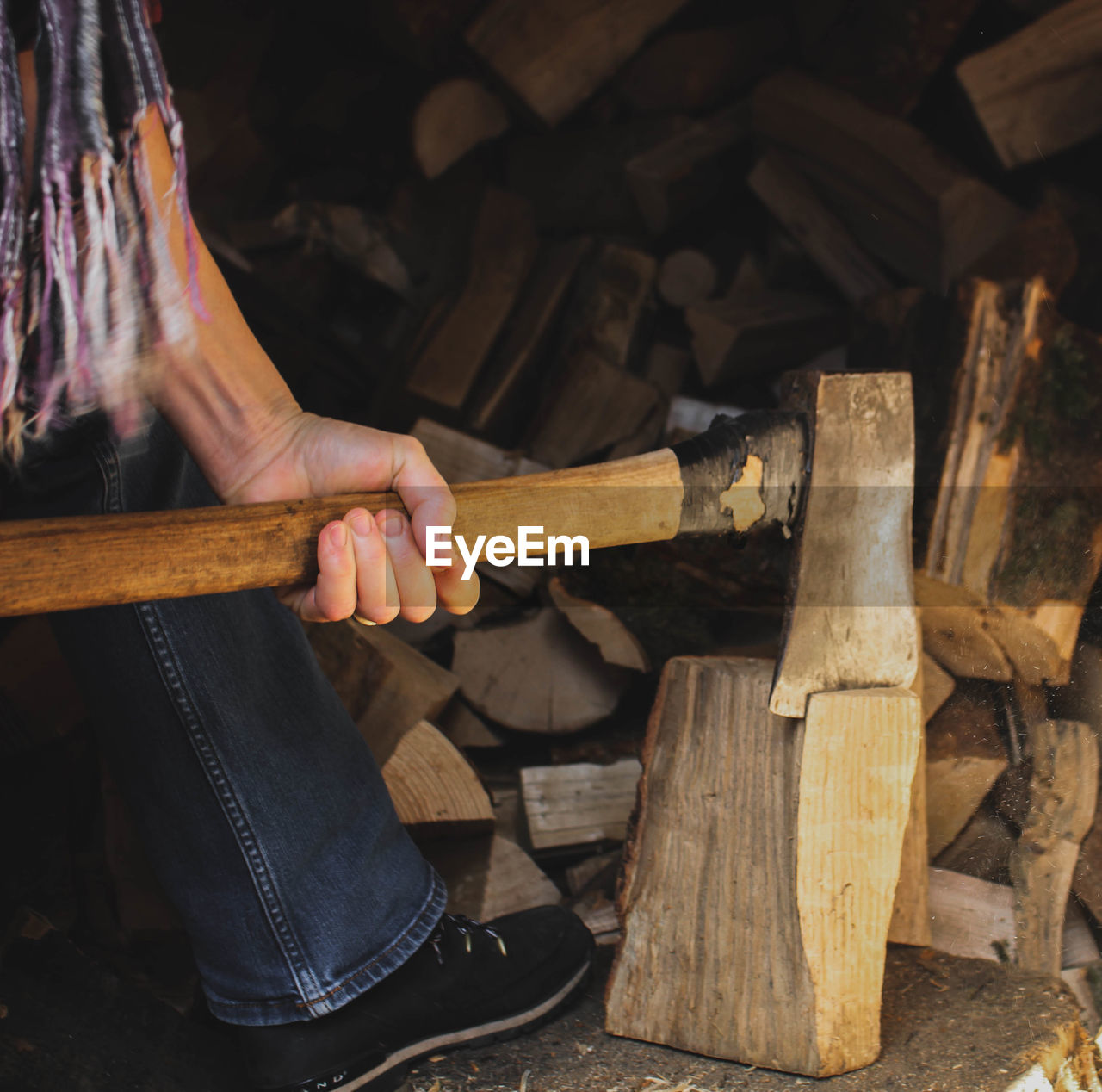 wood - material, real people, wood, one person, log, timber, men, axe, firewood, human hand, holding, occupation, hand, human body part, work tool, deforestation, indoors, lifestyles, workshop, hand saw