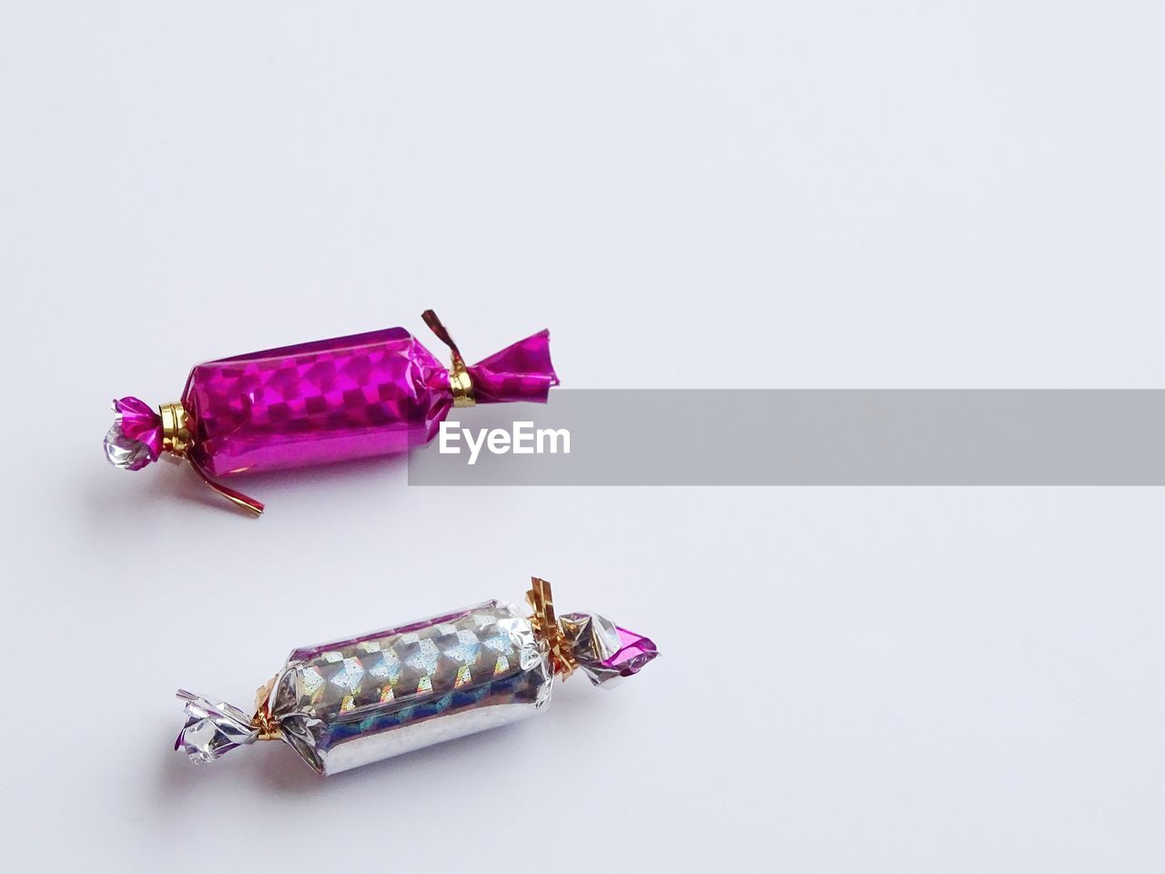 studio shot, white background, copy space, still life, indoors, no people, high angle view, sweet food, food and drink, close-up, pink color, food, cut out, sweet, group of objects, dessert, table, purple, indulgence, two objects, temptation