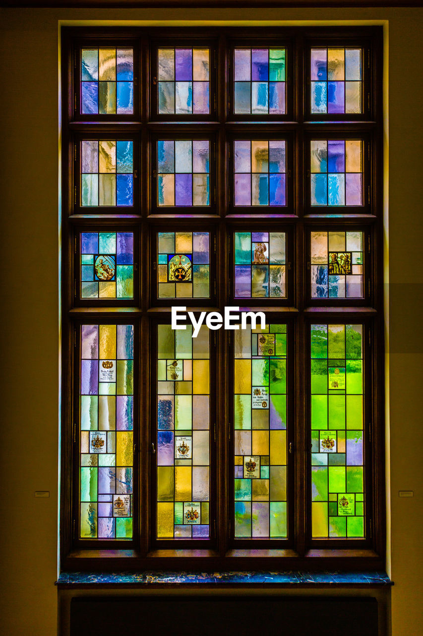 window, glass - material, no people, architecture, glass, indoors, multi colored, transparent, stained glass, building, built structure, day, pattern, in a row, geometric shape, backgrounds, close-up, grid, window frame