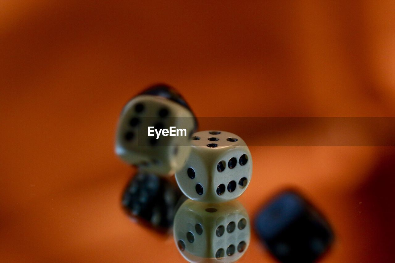 Close-Up Of Dices On Glass With Reflections