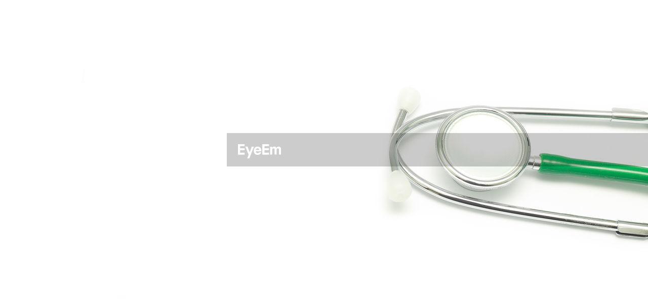 Cropped stethoscope over white background