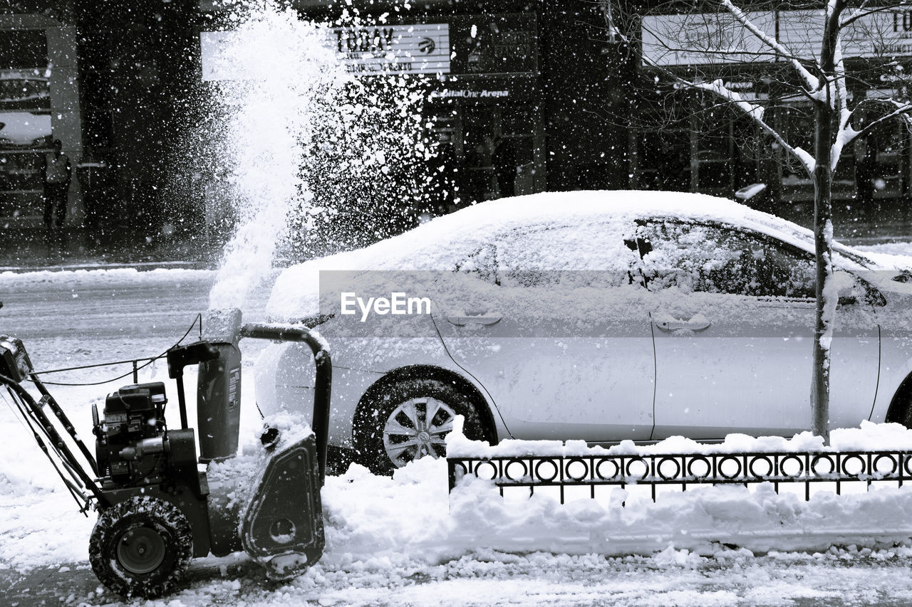 snow, winter, motion, cold temperature, transportation, land vehicle, day, nature, mode of transportation, car, architecture, water, motor vehicle, outdoors, spraying, one person, snowing, real people, blizzard