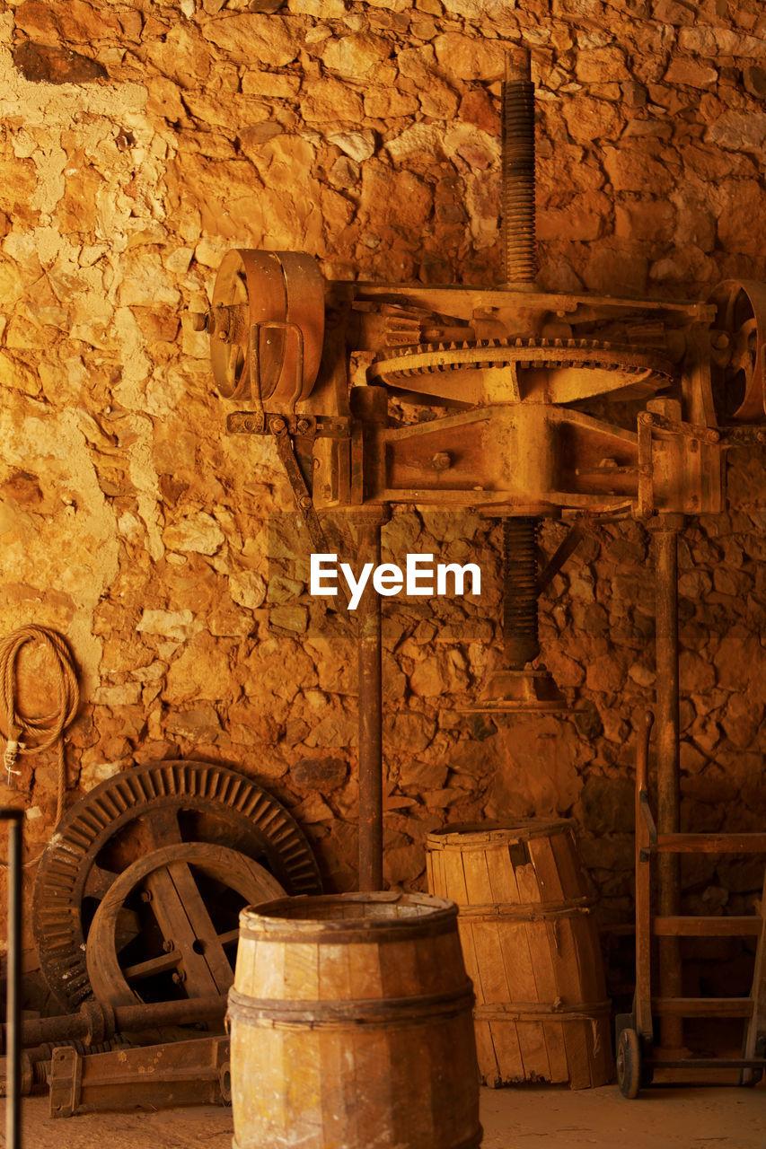 old, indoors, architecture, no people, barrel, metal, history, wood - material, built structure, wall - building feature, the past, cellar, industry, wine cellar, wall, building, wine cask, domestic room, abandoned, wine, winemaking