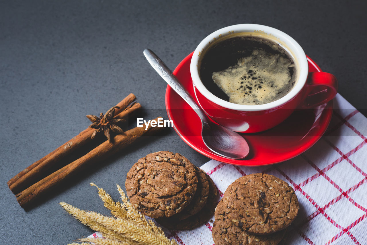 food and drink, food, refreshment, drink, freshness, cup, still life, high angle view, baked, cookie, table, mug, indoors, coffee cup, coffee, sweet food, indulgence, no people, chocolate, coffee - drink, temptation, crockery, chocolate chip cookie, snack