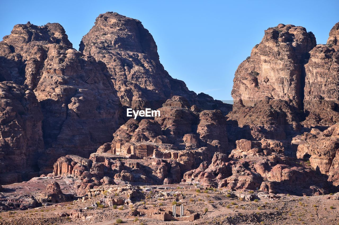 rock, rock formation, rock - object, solid, sky, mountain, nature, physical geography, geology, no people, travel, travel destinations, day, tranquil scene, scenics - nature, tranquility, tourism, history, beauty in nature, sunlight, mountain range, outdoors, formation, ancient civilization, eroded, arid climate, climate, ruined, archaeology