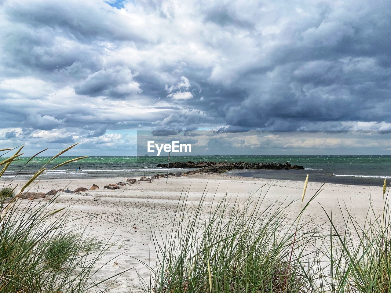 cloud - sky, sky, water, beauty in nature, plant, scenics - nature, land, tranquility, beach, tranquil scene, sea, nature, grass, sand, growth, day, non-urban scene, no people, marram grass, outdoors, horizon over water