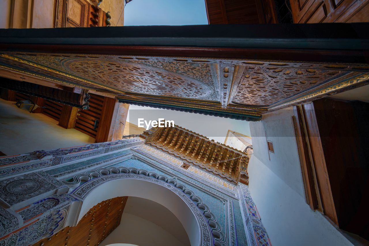 architecture, built structure, low angle view, building, indoors, no people, religion, the past, history, day, place of worship, ceiling, belief, travel destinations, spirituality, pattern, design, window, art and craft, ornate, architectural column, directly below