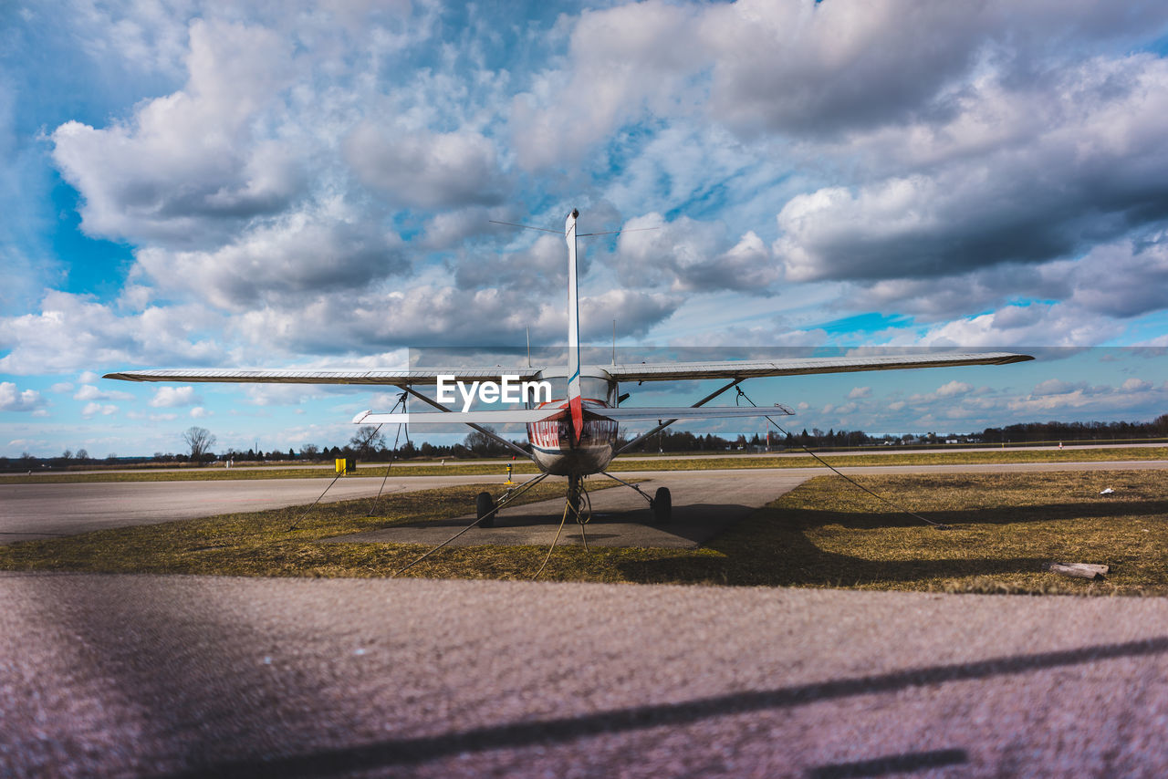 cloud - sky, sky, transportation, nature, real people, one person, day, air vehicle, mode of transportation, airport, airplane, road, travel, lifestyles, sunlight, outdoors, environment, beauty in nature, sport