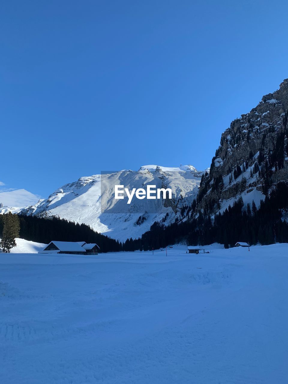winter, snow, beauty in nature, cold temperature, scenics - nature, sky, mountain, tranquil scene, tranquility, blue, non-urban scene, clear sky, environment, nature, snowcapped mountain, mountain range, idyllic, copy space, landscape, no people, outdoors, mountain peak