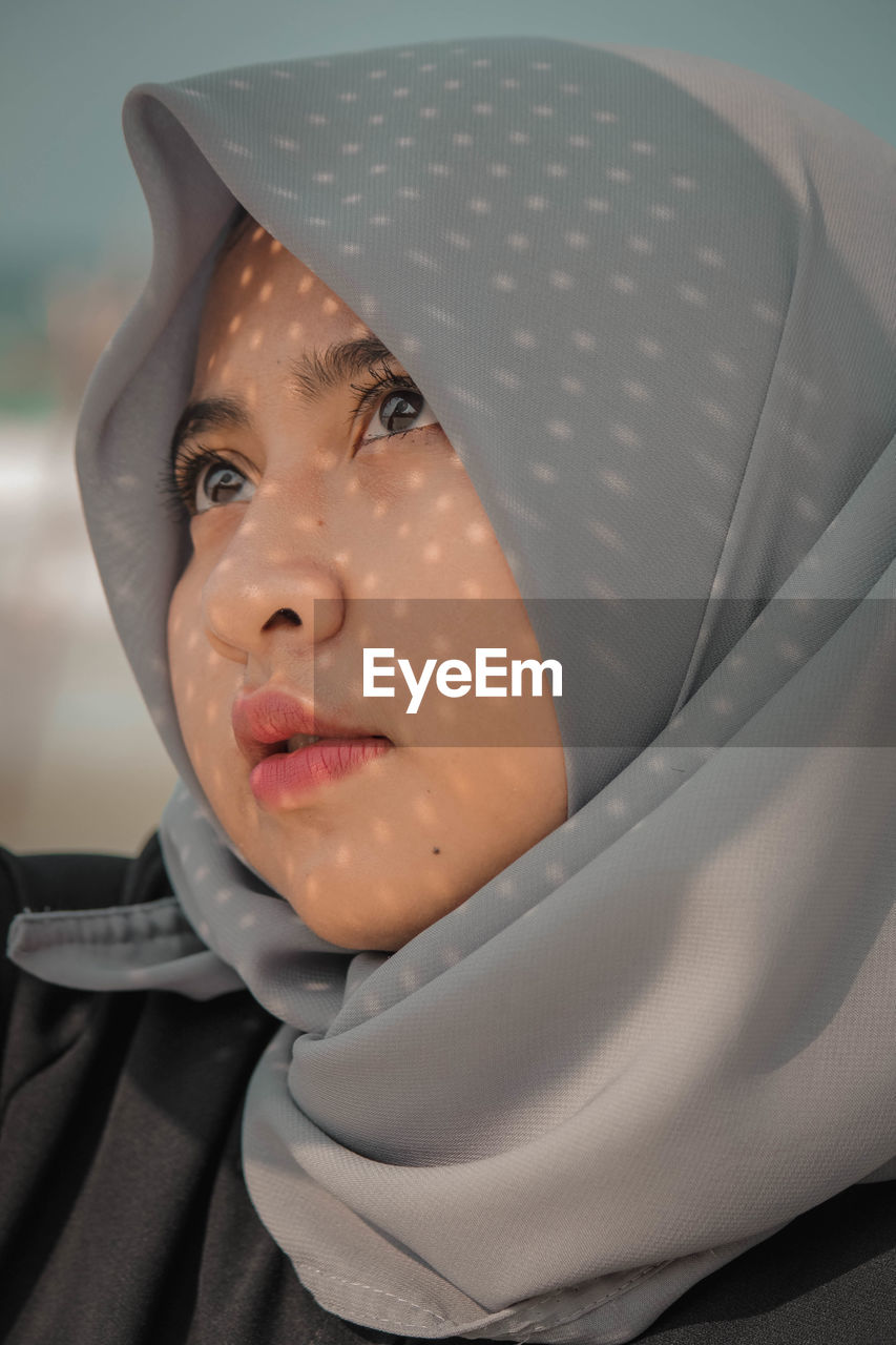 Close-up of young woman in hijab