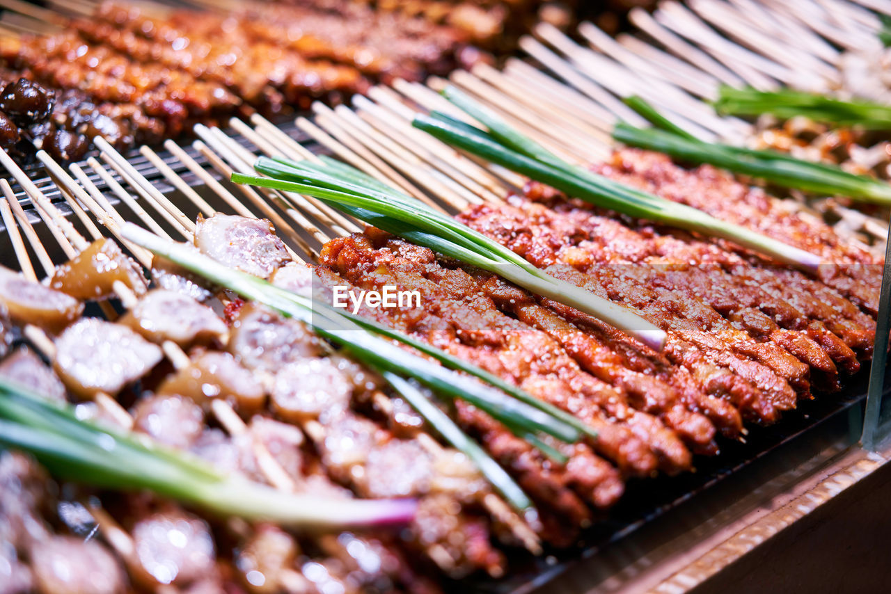 food, food and drink, freshness, meat, still life, selective focus, barbecue, close-up, no people, indoors, grilled, indulgence, ready-to-eat, healthy eating, high angle view, preparation, wellbeing, abundance, large group of objects, day, beef, temptation