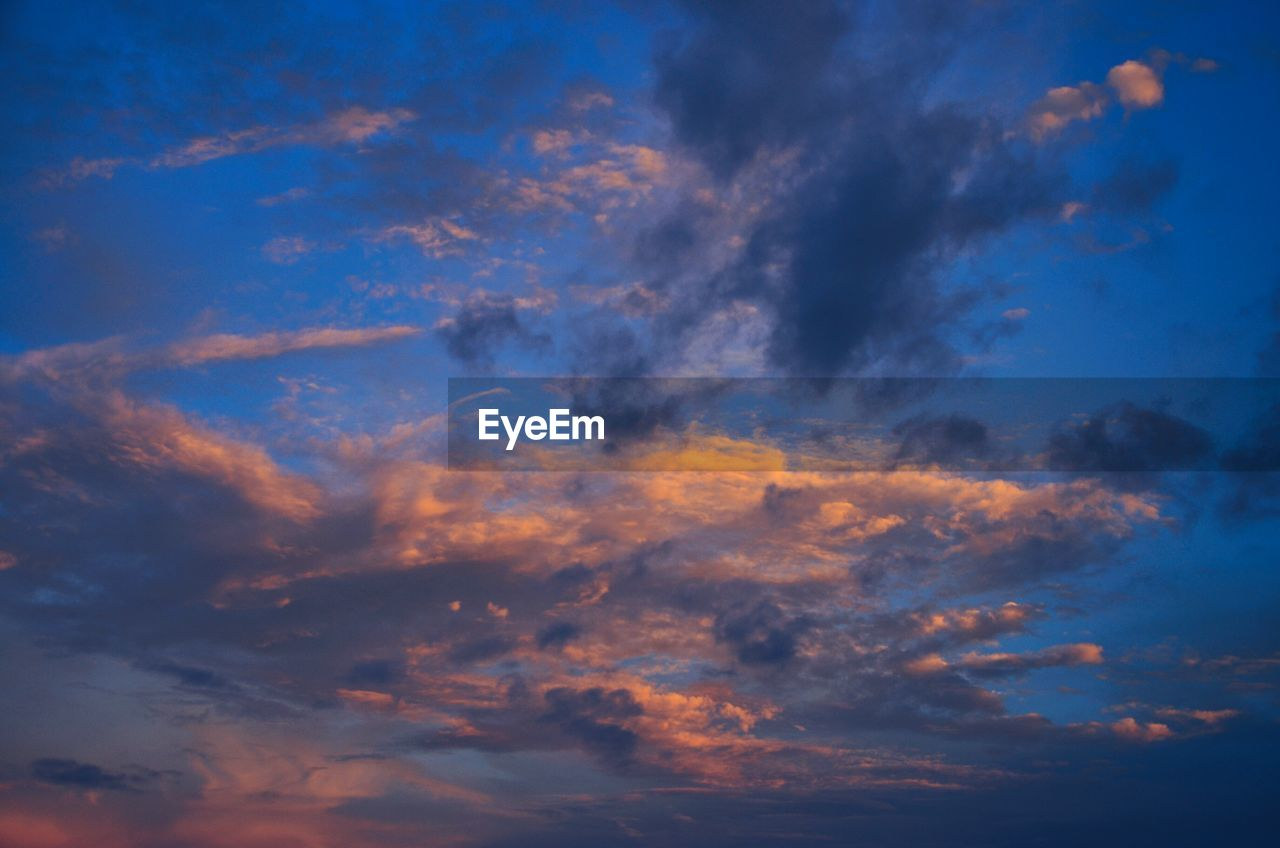 sky, beauty in nature, low angle view, cloud - sky, nature, scenics, blue, backgrounds, sky only, tranquility, tranquil scene, dramatic sky, idyllic, no people, outdoors, full frame, sunset, day