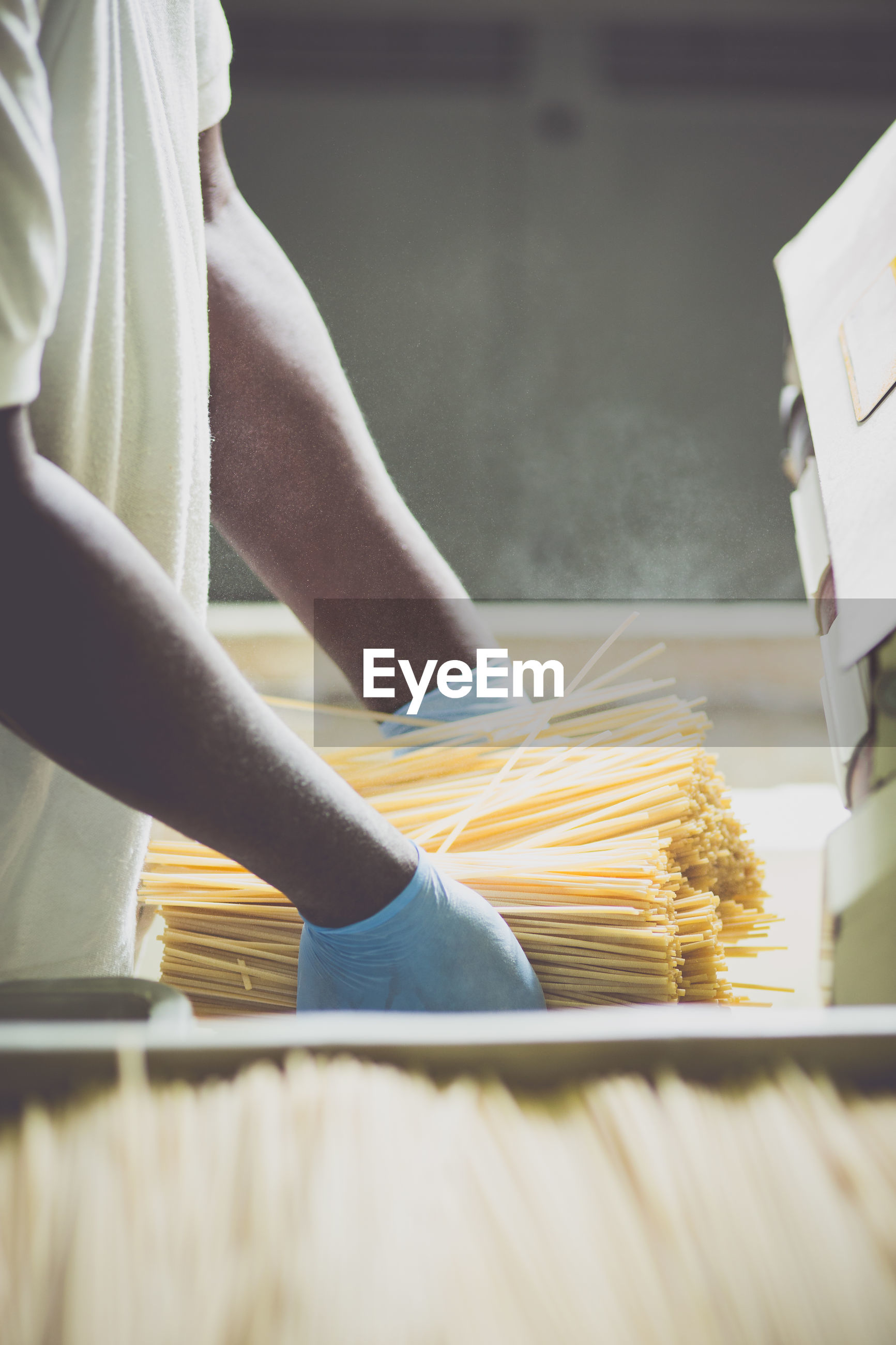 Midsection of man holding raw pastas