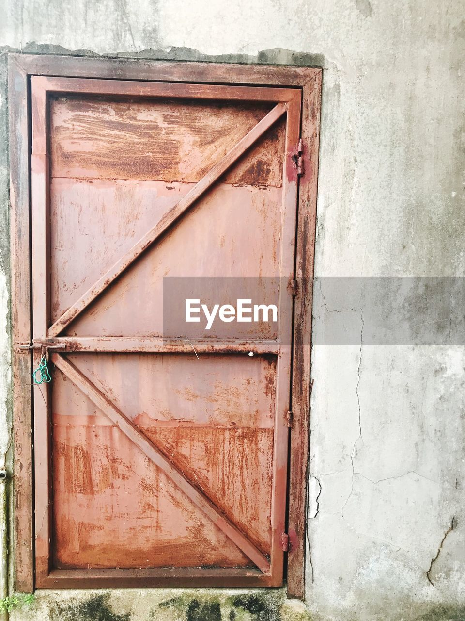architecture, built structure, no people, entrance, wood - material, door, building exterior, old, wall - building feature, closed, day, window, metal, weathered, safety, outdoors, security, house, building, wall, deterioration