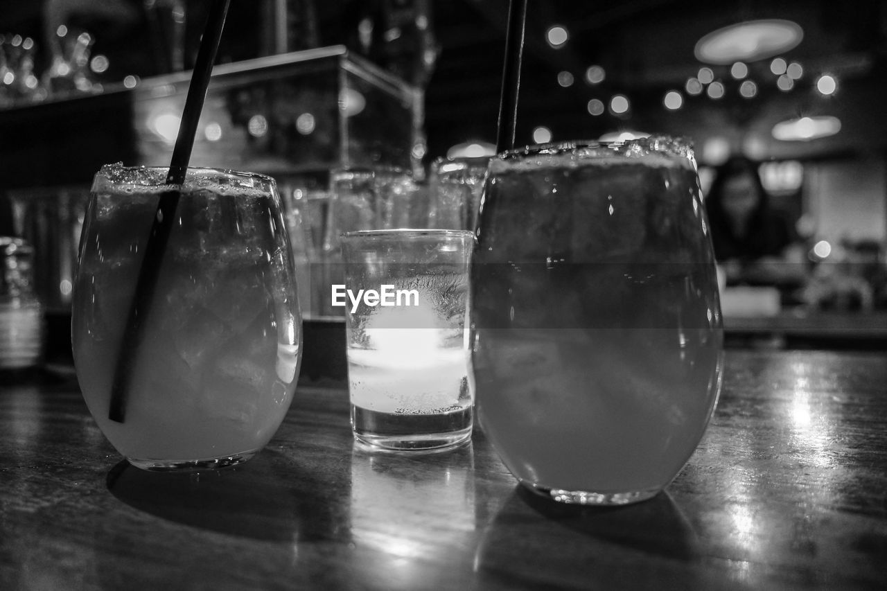table, food and drink, indoors, focus on foreground, close-up, restaurant, refreshment, drink, no people, night, freshness, drinking glass, food, illuminated, ready-to-eat