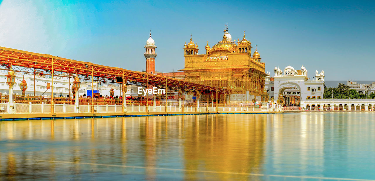 Reflection of building in water harmandir sahib