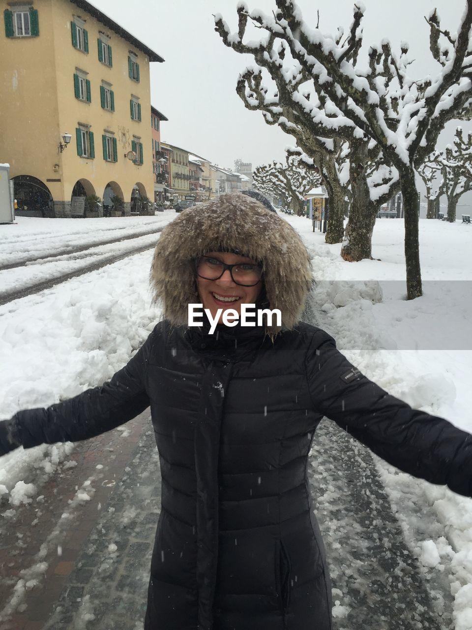 Young Woman Wearing Fur Hood During Snowfall