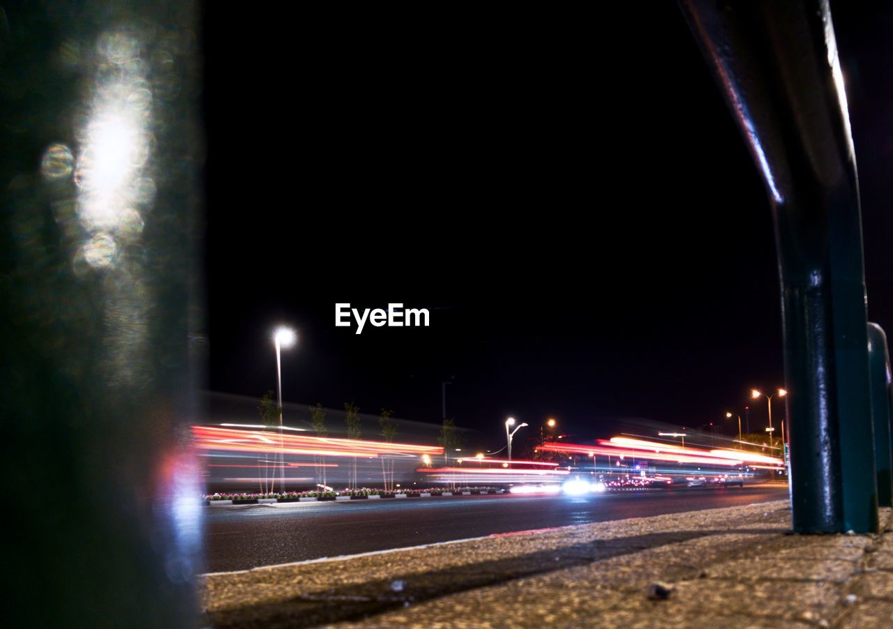 illuminated, night, long exposure, light trail, motion, speed, transportation, blurred motion, street light, high street, outdoors, no people, architecture, sky