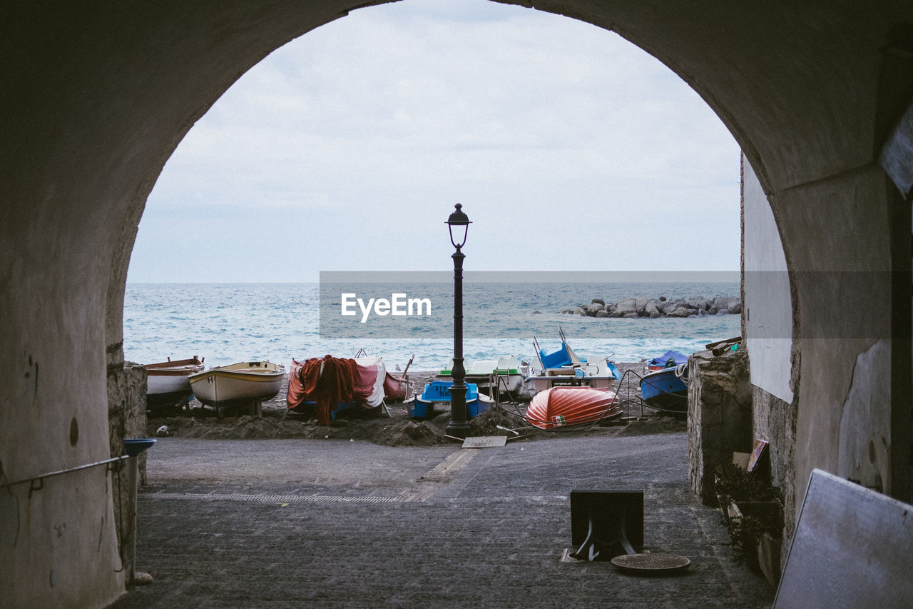 Sea Water Sky Horizon Over Water Arch Horizon Architecture Nature Beach Day Land Built Structure Seat Real People Chair Relaxation Beauty In Nature Cloud - Sky People Outdoors Morning Lamppost Boats Archway Italy Amalfi Coast Harbor