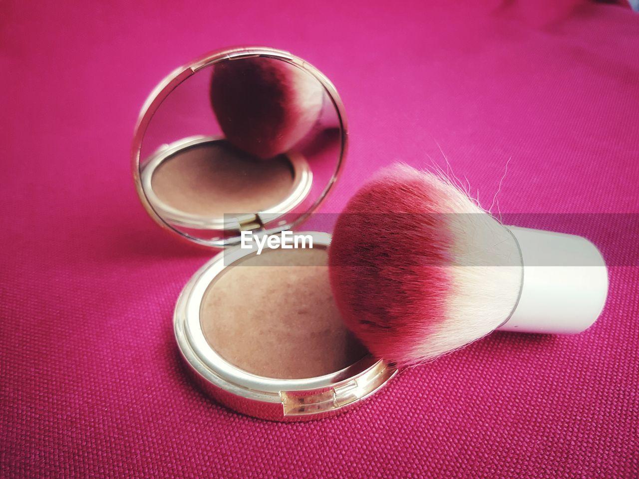 Close-Up Of Make-Up Brush On Blush On Table